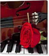 Violin And Rose On Piano Canvas Print