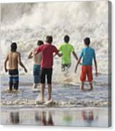 Wading In The Surf Canvas Print
