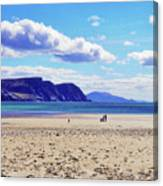 Wandering On The Beach Under The Clouds Canvas Print