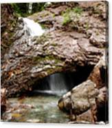 Waterfall Into A Cave Canvas Print