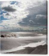 Waves Breaking Against The Beach And Cloud Streaming Above  Skegness Lincolnshire England Canvas Print