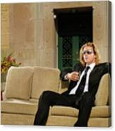 Wealthy Young Man In Suit Sitting On A Couch With A Drink On A T Canvas Print