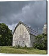 Weathered Barn And Silo Under A Cloudy Sky Canvas Print