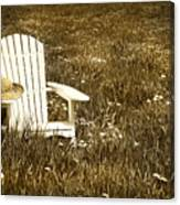 White Chair With Straw Hat In A Field Canvas Print