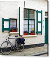 Whitewashed Brick House With Green Trimmed Shutters In Bruges Canvas Print