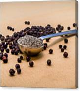 Whole Black Peppercorns With A Heaping Teaspoon Of Ground Pepper Canvas Print