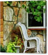 Wicker Rocking Chair On Porch Canvas Print