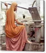 Woman At The Pump Canvas Print