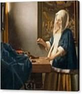 Woman Holding A Balance Canvas Print