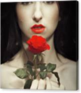 Woman Holding A Red Rose Canvas Print