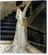 Woman In Lace Gown On Staircase Canvas Print