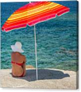 Woman In Red Bikini And White Hat Under Parasol Looking Out To S Canvas Print