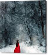 Woman In Red Cape Walking In Snowy Woods Canvas Print