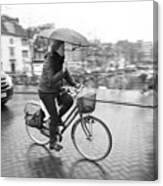Woman Riding In The Raing Canvas Print