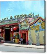 Woman Sits Outside Chinese Temple With Urn And Deity Statues Pattani Thailand Canvas Print