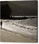 Woman Walking On A Deserted Beach Canvas Print