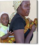 Woman With A Baby In Tanzania Canvas Print