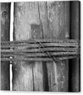 Wood Pilings Tied With Old Rusted Rope Canvas Print