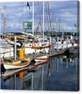Wooden Boats On The Water Canvas Print