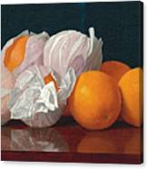 Wrapped Oranges On A Tabletop Canvas Print