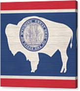 Wyoming Rustic Flag On Wood Canvas Print