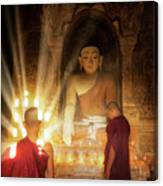 Young Buddhist Monk Are Reading With Sun Light Canvas Print