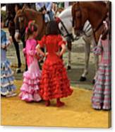 Young Girls In Flamenco Dresses Looking At Horses At The April F Canvas Print