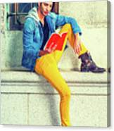Young Man Reading Red Book, Sitting On Street Canvas Print