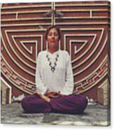Young Woman Sitting And Meditating In A Lotus Position In Front Of A Unique Doors Canvas Print