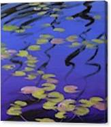 Lilies On Blue Water Canvas Print