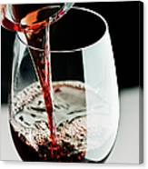 Red Wine Being Poured In A Glass Canvas Print