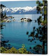 Rocks In A Lake With Mountain Range Canvas Print