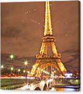 The Eiffel Tower Lit Up At Night In 1 Canvas Print
