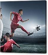 Soccer Player Kicking Ball In Stadium Canvas Print