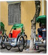 A Cyclo Driver Takes A Nap, In Hoi An, Vietnam. Canvas Print