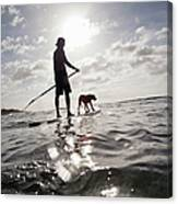 A Man And His Dog On A Stand Up Paddle Canvas Print
