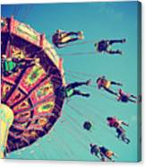 A Swinging Fair Ride At Dusk Toned With Canvas Print
