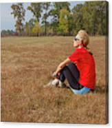 A Woman Is  Sitting In A Park And Admiring The Landscape Canvas Print