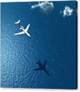 Airplane Flies Over A Sea Canvas Print