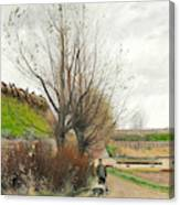Autumn Weather. A Man With A Wheelbarrow On A Path Canvas Print