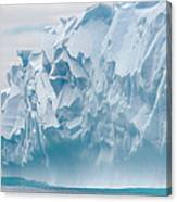 Blue Iceberg Carved By Waves Floats In Canvas Print