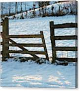 Broken Fence In The Snow At Sunset Canvas Print