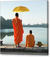 Buddhist Monks Standing In Front Of Canvas Print