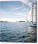 Classic Yacht Sailing Away Against Blue Canvas Print
