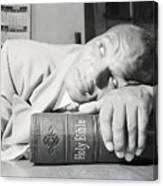 Close-up Of Joe Walcott Resting On Bible Canvas Print