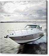 Couple Relaxing On Speed Boat, Dawn Canvas Print