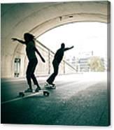 Couple Skateboarding Through Tunnel Canvas Print
