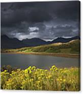 Dark Storm Clouds Hang Over The Canvas Print