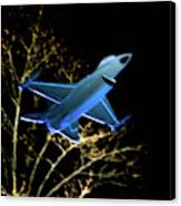 F 16 Lit Up At Night On Glass Monument Canvas Print