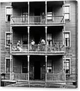 Family On Balcony Of Apartment Building Canvas Print